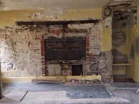 The original hearth in Cliveden's 1767 Kitchen Dependency is in the process of being uncovered. Research indicates the building was also used as living quarters for enslaved workers.